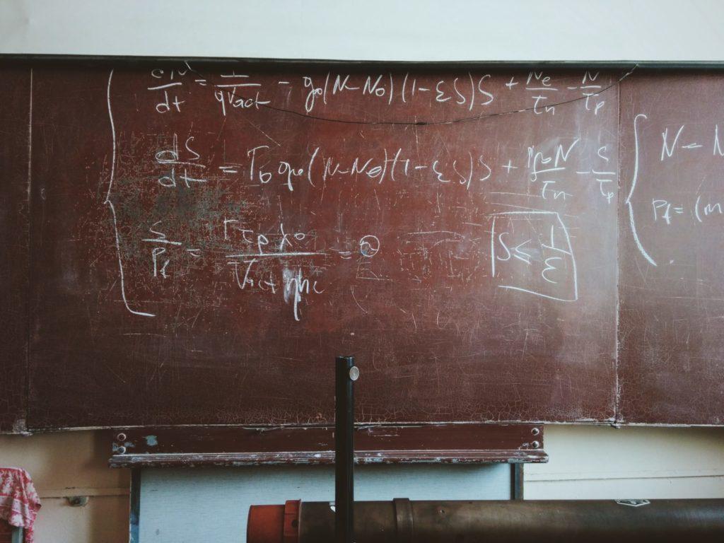 math problem on chalkboard